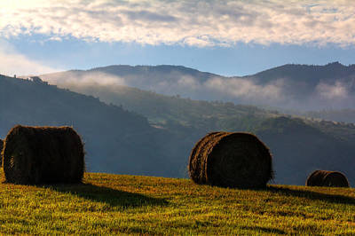 Round Bales And Foggy Hills Print by John McArthur