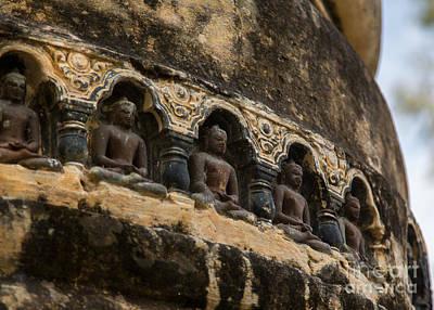 Buddha Photograph - Row Of Buddhas by Mindah-Lee Kumar