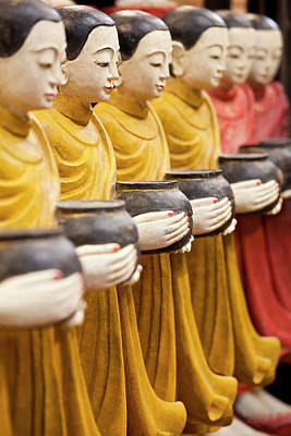 Adam Photograph - Row Of Buddhist Monk Statues Holding by Peter Adams