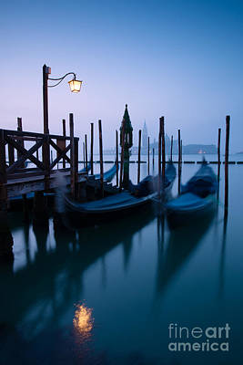 Gondolas Photograph - Row Of Gondolas At Sunrise Venice Italy by Matteo Colombo