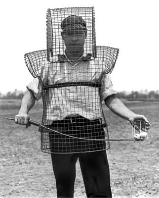Golfer Photograph - Safety Cage For Caddies by Underwood Archives