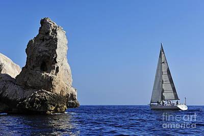 Photograph - Sailboat By Riou Island Rocks by Sami Sarkis