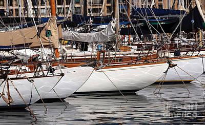 Sailboat Hulls In The Port Print by John Rizzuto