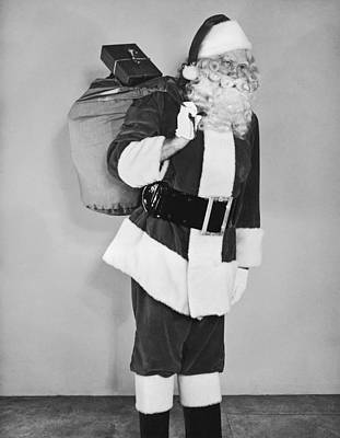 Santa Claus With Presents Print by Underwood Archives