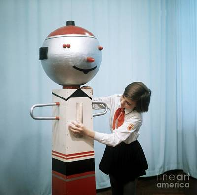 Schoolgirl With Performing Robot Print by Ria Novosti