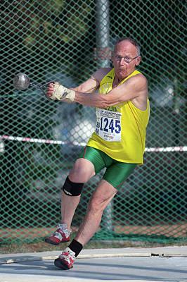 Senior Athlete Prepares Hammer Throw Print by Alex Rotas