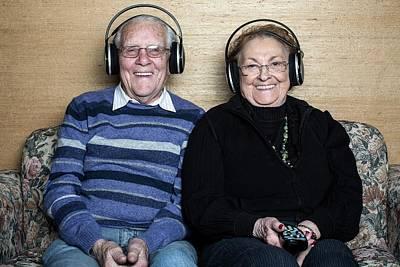 Senior Couple Wearing Headphones Print by Mauro Fermariello