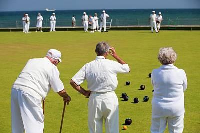 Seniors Playing Bowls At Penzance Print by Ashley Cooper