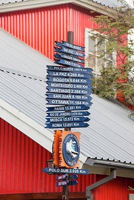 Beagle Photograph - Signposts With Distances To World Cities by Ashley Cooper