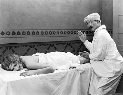 Massaging Photograph - Silent Movie Still by Underwood Archives