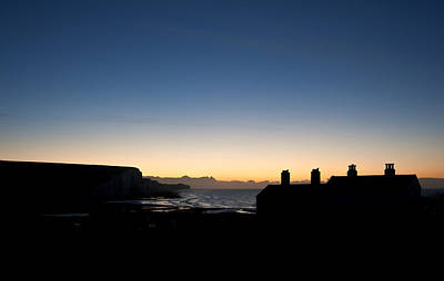 Silhouette Of Coastguard Cottages At Seaford Head At Sunrise Print by Matthew Gibson