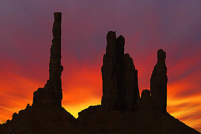 Silhouette Of Totem Pole After Sunset - Monument Valley Print by Mike McGlothlen