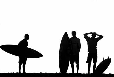 Silhouetted Surfers Print by Sean Davey