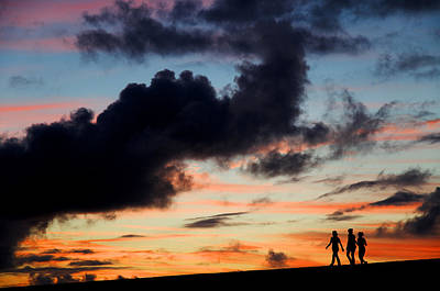 Silhouettes Of Three Girls Walking In The Sunset Print by Fabrizio Troiani
