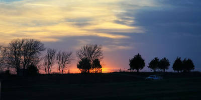 Silhouetts Of A Sunset Print by Joan Bertucci