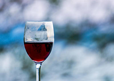 Single Glass Of Red Wine On Blue And White Background Print by Photographic Arts And Design Studio