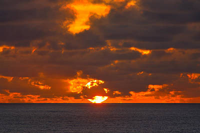 Sunset Photograph - Sinking In The Sea by Greg Norrell