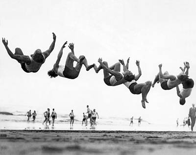 Six Men Doing Beach Flips Print by Underwood Archives