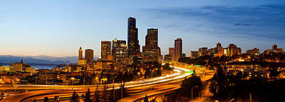 Seattle Skyline Photograph - Skyscrapers Lit Up At Dusk In A City by Panoramic Images