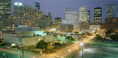 Headlight Photograph - Skyscrapers Lit Up At Night, Houston by Panoramic Images
