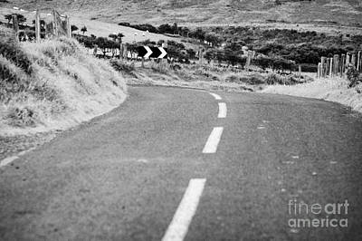 Small Narrow Country Road Leading To Dangerous Bend In County Antrim Northern Ireland Print by Joe Fox