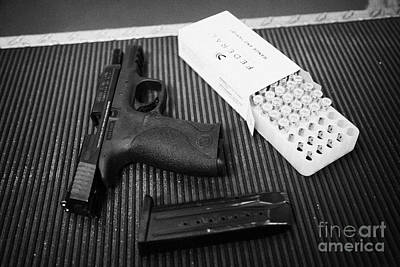 Smith And Wesson 9mm Handgun With Ammunition At A Gun Range Print by Joe Fox