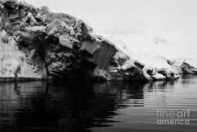 Fournier Photograph - snow covered blue ice shelf falling into the sea at Fournier Bay Antarctica by Joe Fox
