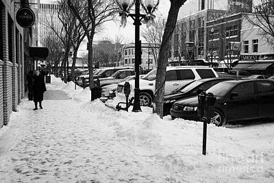 snow covered sidewalk in downtown Saskatoon Saskatchewan Canada Print by Joe Fox