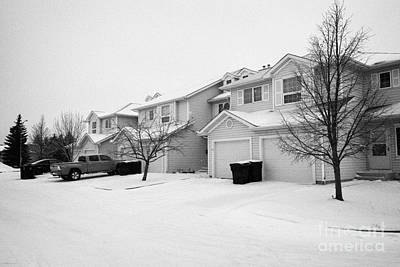 snow falling in residential street during winter Saskatoon Saskatchewan Canada Print by Joe Fox