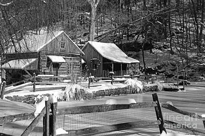 Mill In Woods Photograph - Snowy Cabins In Black And White by Paul Ward