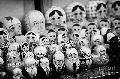 Babushka Photograph - Soviet And Russian Matryoska Dolls On Sale On A Street Stall by Joe Fox