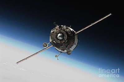 Soyuz Tma 16 Approaching Iss Print by Paul Fearn