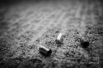 Spent 9mm Handgun Bullet Casings Lying On A Hotel Carpet Floor In The Us Print by Joe Fox