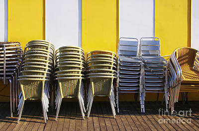Empty Chairs Photograph - Stacks Of Chairs And Tables by Carlos Caetano