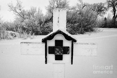 stations of the cross in a graveyard during winter in Forget Saskatchewan Canada Print by Joe Fox