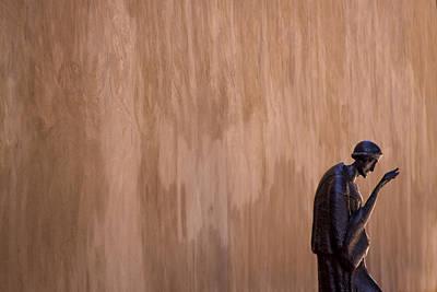 Statuary Photograph - Statue Against Adobe Wall Santa Fe by Carol Leigh