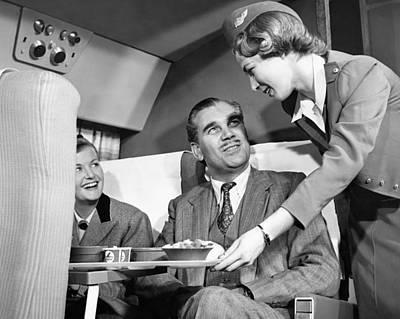 Stewardess Serving Food Print by Underwood Archives