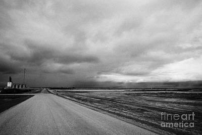 storm snow clouds forming over country road on the prairies assiniboia Saskatchewan Canada Print by Joe Fox