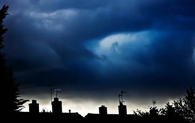 Stormy Roof Tops Of England  Print by Catherine Davies