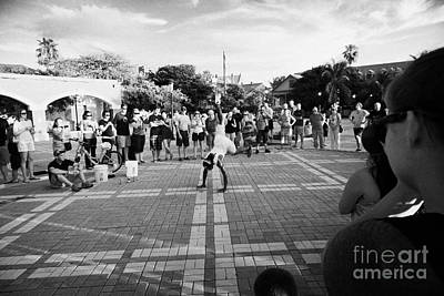 Street Entertainer During Evening Sunset Celebrations Mallory Square Key West Florida Usa Print by Joe Fox