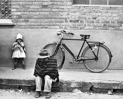Poncho Photograph - Street Scene In Colombia by Underwood Archives