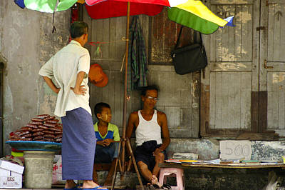 Street Seller Sitting In The Shade Under An Umbrella Yangon Myanmar Print by Ralph A  Ledergerber-Photography