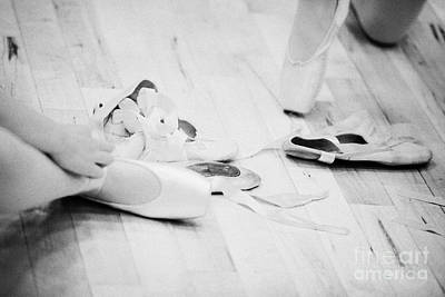 Students Putting On Pointe Shoes At A Ballet School In The Uk Print by Joe Fox