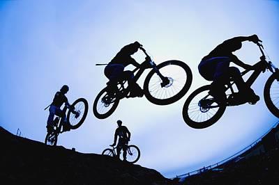Stunt Cyclists, Alberta, Canada Print by Corey Hochachka