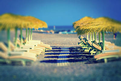 In A Row Photograph - Sunloungers And Parasols On A Beach by Wladimir Bulgar
