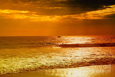 Sunset Photograph - sunset in gold and red at the Hikkaduwa beach by Regina Koch