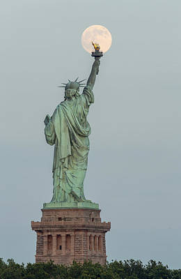 Super Moon Rises Over The Statue Of Liberty Print by Susan Candelario
