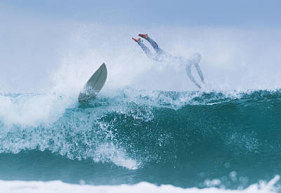 Surfer Diving Into Water Print by Ben Welsh