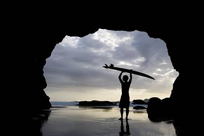 Surfer Inside A Cave At Muriwai North Print by Deddeda