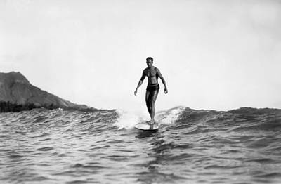 Surfing At Waikiki Beach Print by Underwood Archives